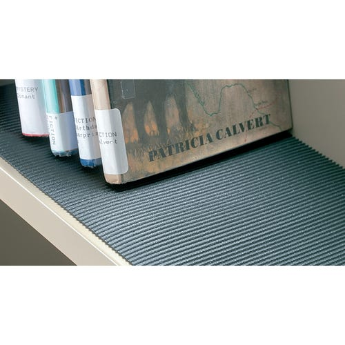 Ribbed, nonskid matting holds books and other materials upright